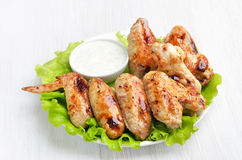 Chicken wings meat on lettuce leaves Stock Images