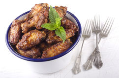 Chicken wings and mint Stock Image
