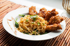 Chicken Wings with Noodles and Spinach Royalty Free Stock Images