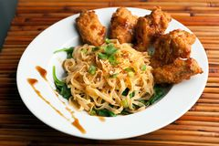 Chicken Wings with Noodles and Spinach Royalty Free Stock Image