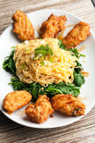 Chicken Wings with Noodles and Spinach Stock Images