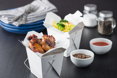 Chicken wings and noodles in take away noodles box. Asian chicken wings and noodles in take-out box Stock Image