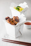 Chicken wings and noodles in take away noodles box Royalty Free Stock Photography