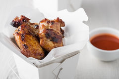 Chicken wings and noodles in take away noodles box Royalty Free Stock Image