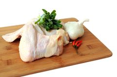 Chicken wings, onion leaf, garlic and pepper Stock Image