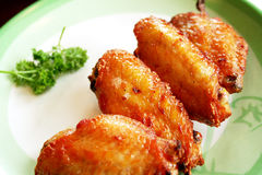 Chicken wings in plate Royalty Free Stock Photos
