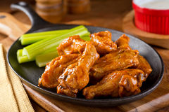 Chicken Wings. A plate of delicious Buffalo style chicken wings with celery and dipping sauce royalty free stock images