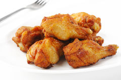 Chicken wings on plate Stock Images