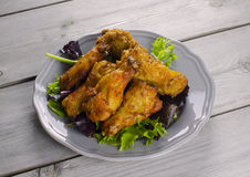 Chicken wings. Plate of chicken wings on wooden table Stock Photos
