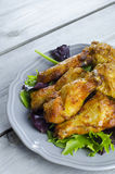 Chicken wings. Plate of chicken wings on wooden table Royalty Free Stock Photos