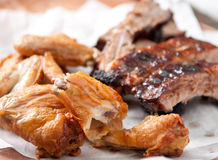 Chicken wings and pork ribs Stock Image