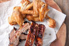 Chicken wings and pork ribs Stock Photos