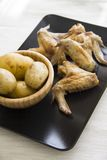 Chicken wings and potato closeup 3/4 Royalty Free Stock Photo