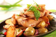 Chicken wings and potatoes Royalty Free Stock Photo