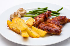 Chicken wings with potatoes Royalty Free Stock Image