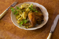 Chicken wings and potatoes. On the table Stock Images