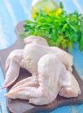 Chicken wings. Raw chicken wings on board Stock Photo
