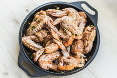 Chicken wings ready for barbecue stock image