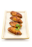 Chicken Wing. S and red sauce with coriander isolated on white background Royalty Free Stock Photo