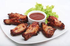 Chicken Wings with Red Sauce. In white plate royalty free stock image