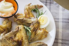 Chicken wings with rosemary and eggs Royalty Free Stock Photos