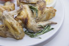 Chicken wings with rosemary Stock Images