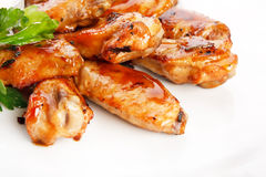 Chicken wings with sauce. Closeup royalty free stock image
