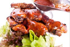 Chicken wings, sauce. Royalty Free Stock Images