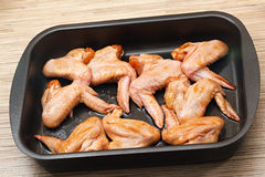 Chicken wings with sauce for baking. Stock Image