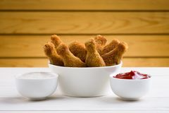 Chicken wings and sauces Stock Images