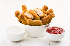 Chicken wings and sauces. On the table Stock Photos