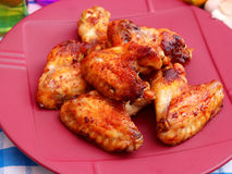 Chicken Wings. Some grilled chicken wings with paprika royalty free stock images