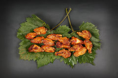 Chicken wings on some leaves Royalty Free Stock Photos