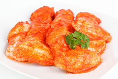 Chicken wings. Some raw chicken wingson a plate stock image