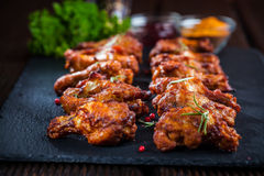 Chicken wings with spices and herbs Royalty Free Stock Image