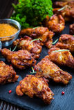 Chicken wings with spices and herbs Stock Image