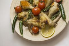 Chicken wings  with  tomato,chili and rosemary Stock Photos
