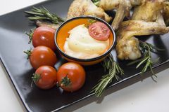 Chicken wings  with  tomato and rosemary Royalty Free Stock Photos