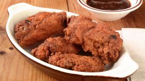 Chicken wings vanishing from a bowl stock video footage