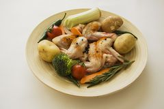Chicken wings with variety of vegetables Stock Images