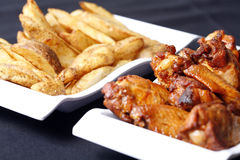 Chicken wings and wedges Stock Photos