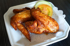 Chicken wings. In a white plate Stock Images
