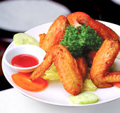 Chicken wings on white plate Stock Photo