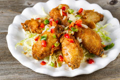 Chicken wings in white plate ready to eat Stock Photos