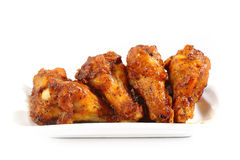 Chicken wings on a white plate Royalty Free Stock Images