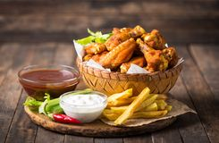 Chicken Wings With Dips On The Wooden Table Royalty Free Stock Images