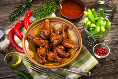 Chicken wings. On wooden background Stock Photo