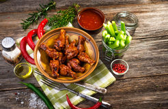 Chicken wings. On wooden background Stock Images