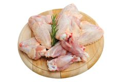 Chicken wings on a wooden cutting board Royalty Free Stock Photo