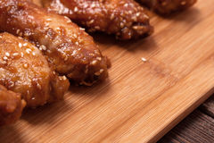 Chicken wings on a wooden table. Royalty Free Stock Image